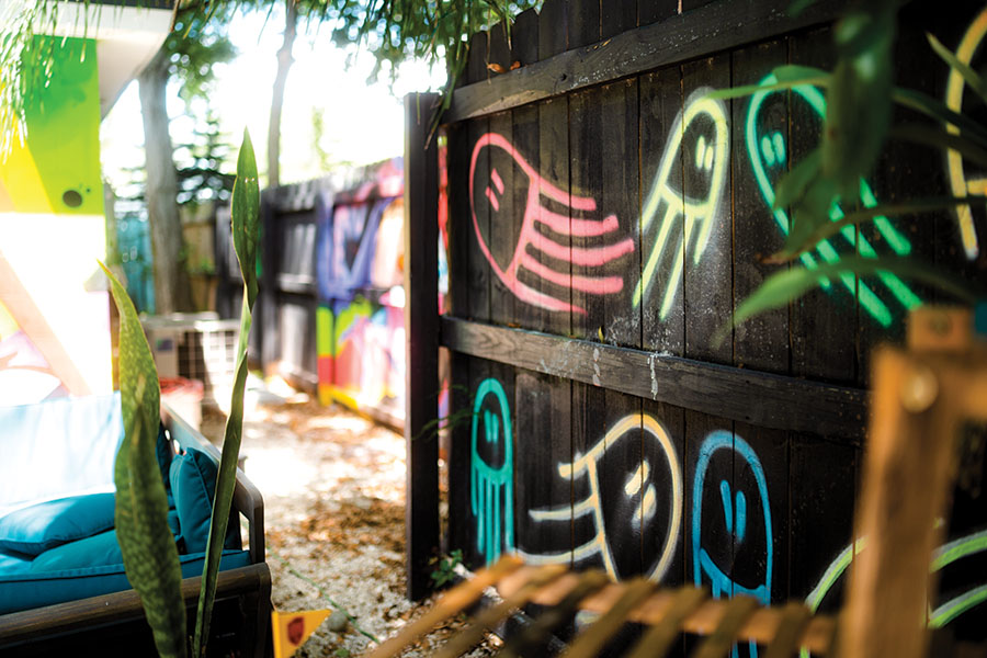 Eclectic and eye-catching graffiti murals cover  walls, fences and houses in Bradenton's Village of the Arts. Photography by Wyatt Kostygan