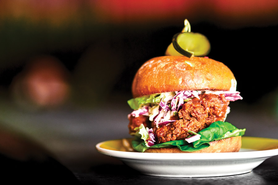 The Kim Chee Yum  sandwich pairs fried chicken with kim chee  slaw and Korean pickle  ssamjung relish.Photography by Wyatt Kostygan.